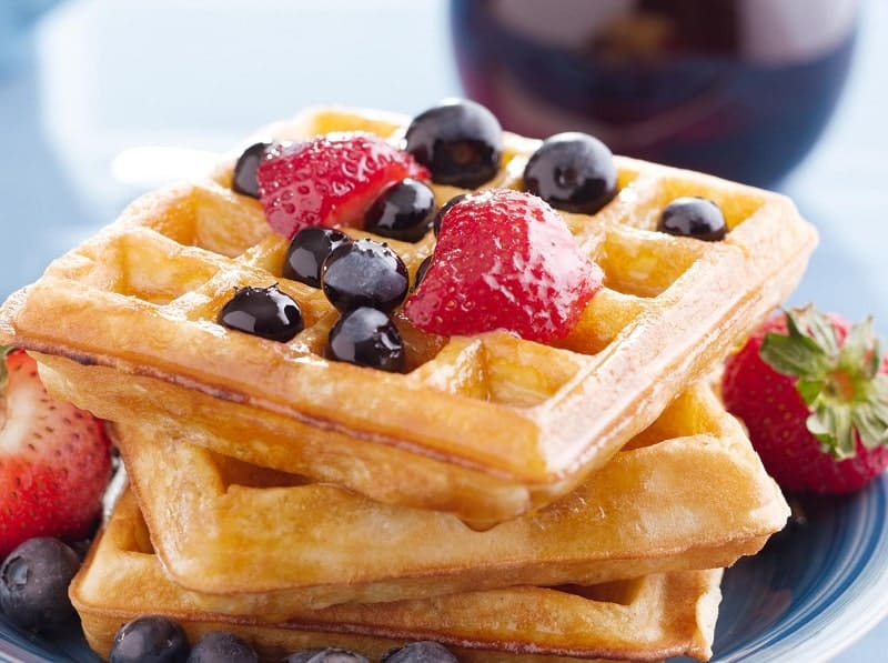 blueberry waffles with strawberries, shot with selective focus